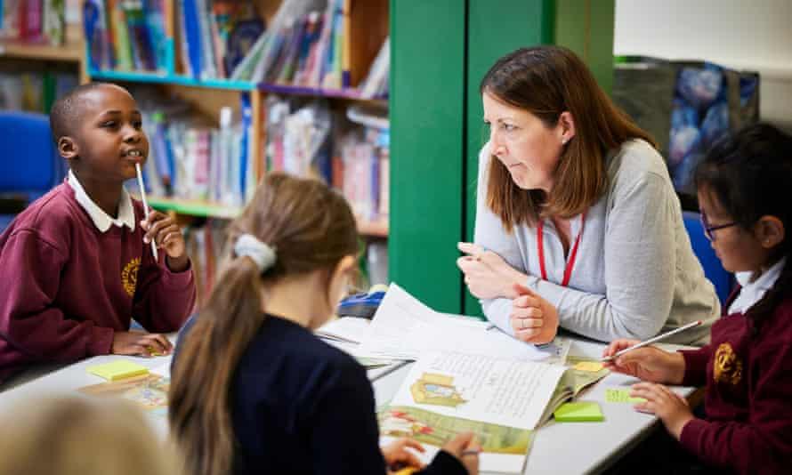 A tutor, Tamzin, with children at Thameside primary school, Abingdon, Oxford