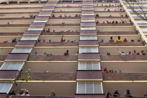 Residents of the Hillbrow neighbourhood in central Johannesburg wave from the balconies of their homes during the Covid-19 lockdown.