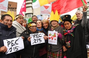 The actress Emma Thompson, centre, and fashion designer Dame Vivienne Westwood, third left, attend the London march