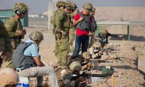 Australian soldiers work alongside Iraqi interpreters as part of Task Force Taji, training Iraqi security forces.