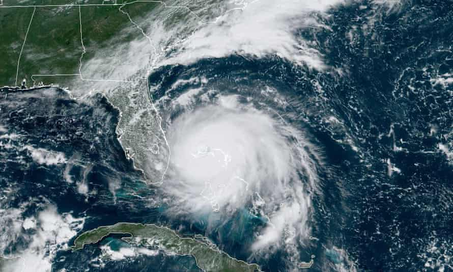 """US-WEATHER-HURRICANE<br>This satellite image obtained from NOAA/RAMMB, shows Tropical Storm Dorian as it approaches the Bahamas at 15:30 UTC on September 2, 2019. - Hurricane Dorian battered the Bahamas with ferocious wind and rain on Sunday, the monstrous Category 5 storm wrecking towns and homes as it churned on an uncertain path toward the US coast where hundreds of thousands were ordered to evacuate. Packing sustained winds of 165 miles per hour (270 kph) with a towering 18 to 23 foot (5 to 7 metre) storm surge, Dorian crashed over the Abacos Islands, in the northwest Bahamas, as the strongest storm ever to hit the Caribbean chain. (Photo by NOAA / NOAA/RAMMB / AFP) / RESTRICTED TO EDITORIAL USE - MANDATORY CREDIT """"AFP PHOTO / NOAA/RAMMB/HANDOUT"""" - NO MARKETING - NO ADVERTISING CAMPAIGNS - DISTRIBUTED AS A SERVICE TO CLIENTSNOAA/AFP/Getty Images"""