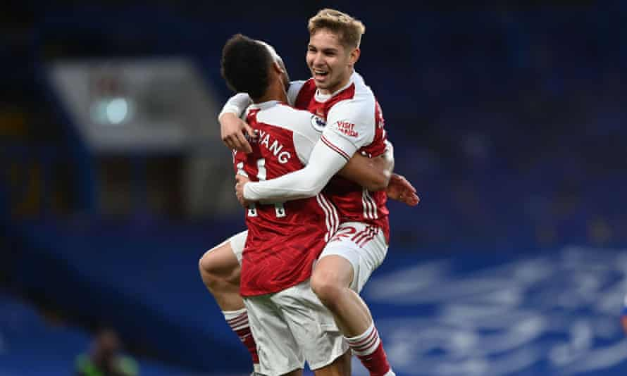 Arsenal's Emile Smith Rowe celebrates with Pierre-Emerick Aubameyang after taking advantage of a defensive blunder from Chelsea's Jorginho.