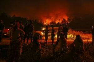 Flames and smoke rise after a fire broke out in the province of Izmir, Turkey.