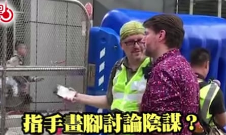 "A screen grab of a social media post circulating in Hong Kong featuring a foreign worker. The caption says: ""Gesticulating and discussing a plot?"" China has been circulating images of foreigners, accusing them of stoking unrest in Hong Kong."