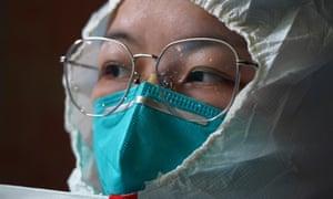Nurse Zhou Li wears a protective suit before entering a ward at Xianghu Hospital of the First Affiliated Hospital of Nanchang University in Nanchang, east China's Jiangxi Province