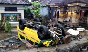 An overturned car after a tsunami in Indonesia