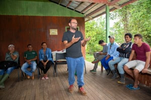 Veja co-founder Sébastien Kopp talks to the local seringueiros (rubber tappers) during their community meeting.