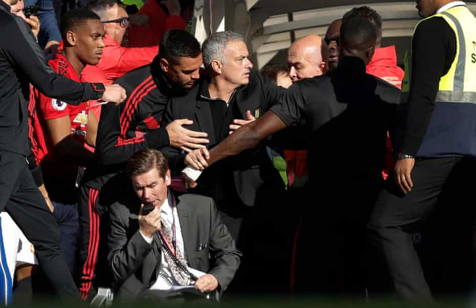 Jose Mourinho (centre) has to be restrained during a tunnel fracas after the late Chelsea equaliser during the Chelsea v Manchester United Premier League match at Stamford Bridge in October 2018