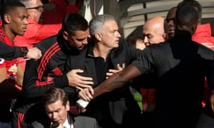 José Mourinho has to be restrained after Chelsea's late equaliser against Manchester United in 2018
