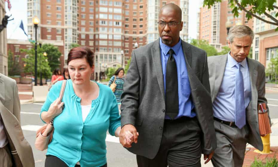 The former CIA officer Jeffrey Sterling, center, accompanied by his wife Holly, left, and his attorney, Barry Pollack, right, departs federal court in Alexandria, Virginia, on Monday after he was sentenced to forty two months.