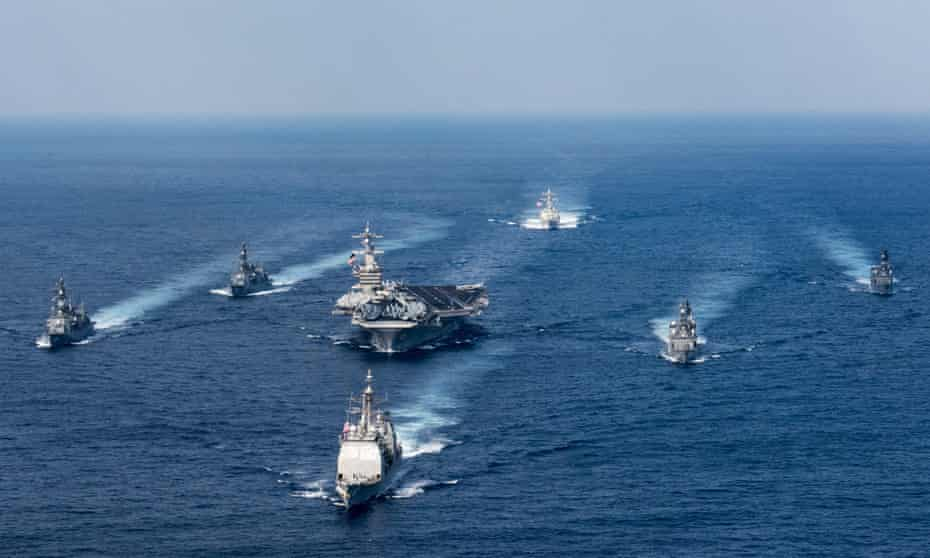 The US navy aircraft carrier USS Carl Vinson, the guided-missile destroyer USS Wayne E Meyer and the guided-missile cruiser USS Lake Champlain participate in an exercise with Japanese destroyers in March.