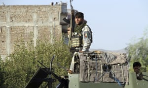 Afghan security forces at the site of a suicide bombing and gun battle in Jalalabad last week