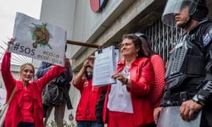 Acción Ecológica's Alexandra Almeida at Ecuador's Ministry of Environment yesterday responding to a government attempt to close the organisation.