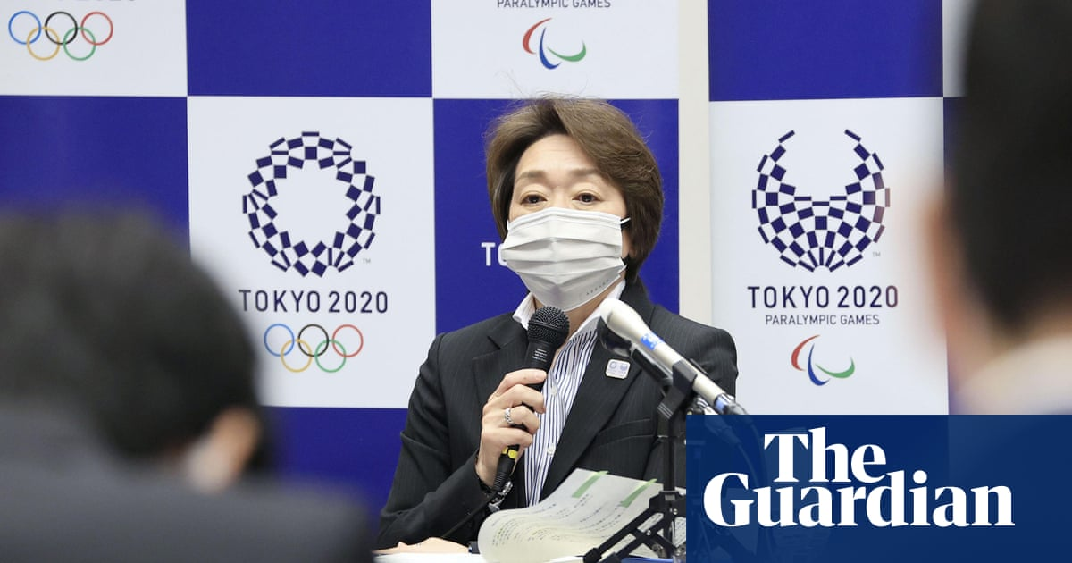 Olympics will go ahead, says Tokyo Games chief, after Covid official voices concerns