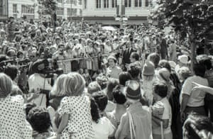 Crowds of people watch the arrival of Queen Elizabeth II and Prince Philip at Sydney Square on 13 March 1977