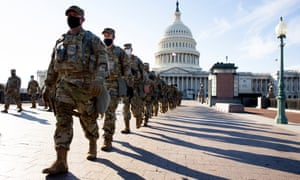 Members of the national guard marching at the East Front of the US Capitol in Washington DC today.