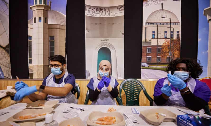 NHS staff prepare vaccinations at a pop-up vaccination centre at the Baitul Futuh Mosque in Morden, London.
