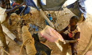 A 10-year-old boy manually ventilates a pit at a gold mine in Tindangou, a village in the east of Burkina Faso