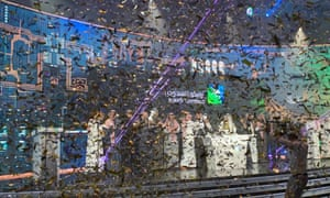 Saudi Aramco executives are showered with ticker tape during a ceremony at the Tadawul stock exchange in Riyadh