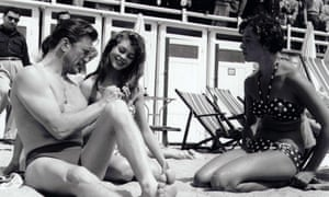Brigitte Bardot (centre) with Kirk Douglas in Cannes.