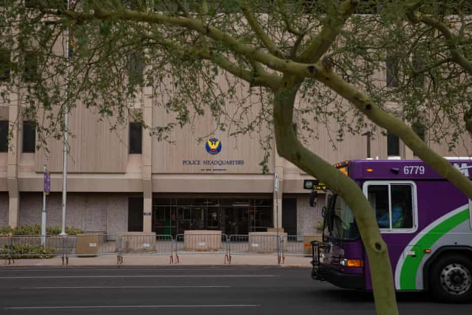 A Valley Metro bus drives past the Phoenix police headquarters.