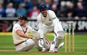 Jamie Overton of Somerset and Dane Vilas of Lancashire react after a near run-out.