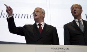 FILE - In this March 13, 2014 file photo then Volkswagen CEO Martin Winterkorn, left, and CFO Hans Dieter Poetsch, right, arrive for the company's annual press conference in Berlin, Germany. (AP Photo/Michael Sohn, file)