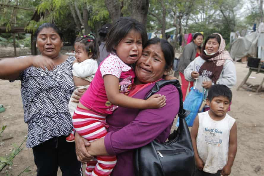 Guaraní protesters in August flee police, who pursued them to the village of Yatirenda, and then proceeded to smash car windows, kick down doors and drag people from their homes.