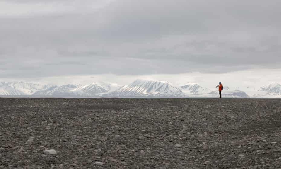 Dwarfed by the 'sterile magnificence' of the landscape: one of the Arctic Circle residency team on Svalbard last month.