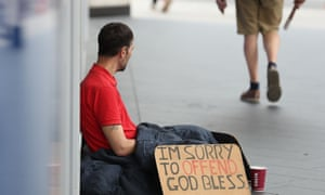 Homeless man ignored by passer-by, despite card reading 'I'm sorry to offend, God bless'