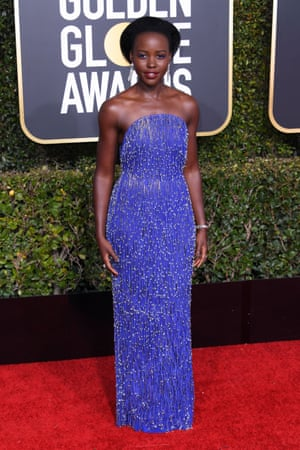 Lupita Nyong'o in Calvin Klein By Appointment bandeau-style sequins.