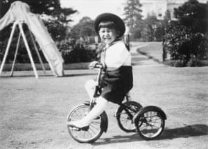 Akihito rides a tricycle in Tokyo in October 1938