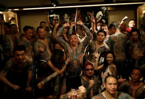 Attendees gather for group photos at the Irezumi Aikokai . 'The event is important because usually we hide our tattoos from society, but just once a year we can proudly show off our tattoos and show each other what new tattoos we've gotten,' said the head of the association, Hiroyuki Nemoto.