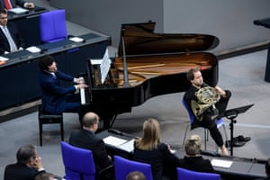 Horn player Felix Klieser (R) and pianist Moritz Ernst perform during a Holocaust commemoration at the German parliament in Berlin
