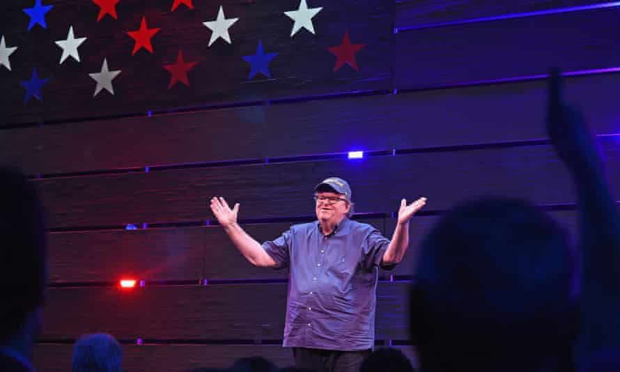 Michael Moore celebrates his Broadway opening night, in August.