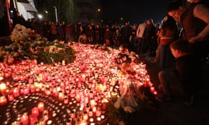 Mourners light candles outside the Colectiv nightclub in Bucharest in memory of the victims of the fire.