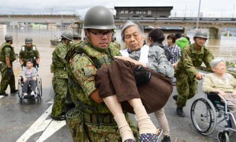 Japan: death toll climbs to 155 after 'historic' rain and landslides