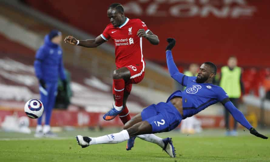 Antonio Rüdiger tackles Liverpool's Sadio Mané at Anfield. The Chelsea defender has impressed since returning to the team.
