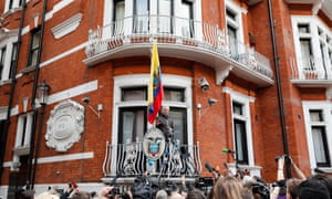 Julian Assange speaks to reporters and supporters on a balcony of the Ecuadorian embassy in London, in May 2017.