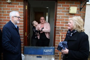 Labour Party leader Jeremy Corbyn meets resident Selena Adamiec and her son Jacob who have been affected by flooding near Pontypridd in South Wales