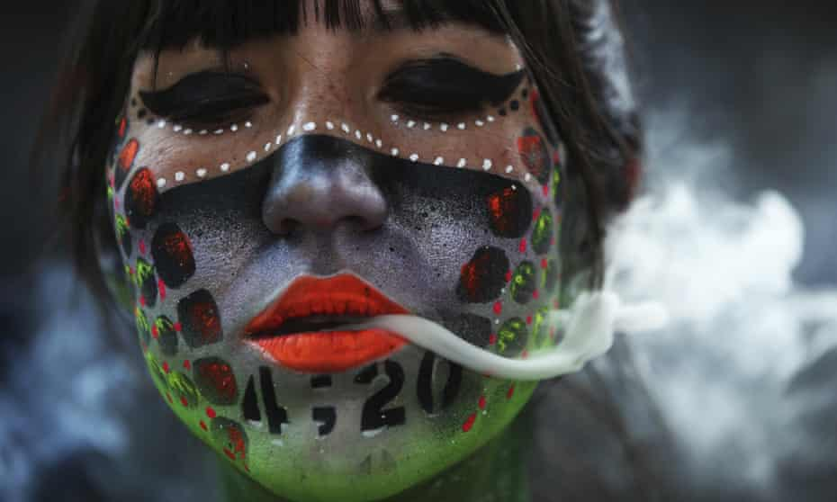 A protester smokes marijuana during a demonstration outside the national senate in Mexico City in April calling for the legalisation of marijuana.