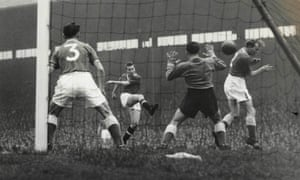 Bobby Charlton scores for Manchester United in a match against Everton on 20 October 1956