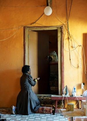 A disciple speaks to Hlongwane through his bedroom door