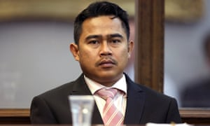 Mohammed Rizalman bin Ismail sits in the dock as he pleads guilty in Wellington to the indecent assault of a New Zealand woman.