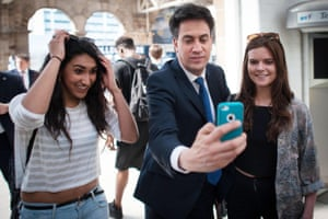 Labour leader Ed Miliband, take a selfie as he meets passengers and passers-by at Sheffield railway station before boarding a train to Leeds to host a Labour Party rally during his campaign tour