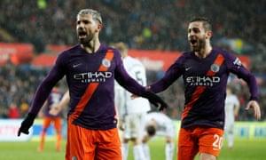 Sergio Agüero (left) celebrates Man City's winning goal with Bernardo Silva.