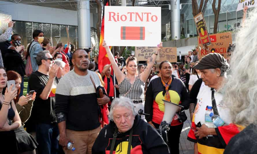 Protesters at a rally outside the Rio Tinto office in Perth on Tuesday.