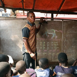 Azonmayon Moses, 21, a teacher and first-time voter, poses with students in the Makoko shanty town in Lagos, 4 February
