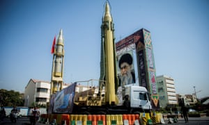 A display featuring missiles and a portrait of Iran's supreme leader, Ayatollah Ali Khamenei,is seen at Baharestan Square in Tehran, Iran, in 2017.