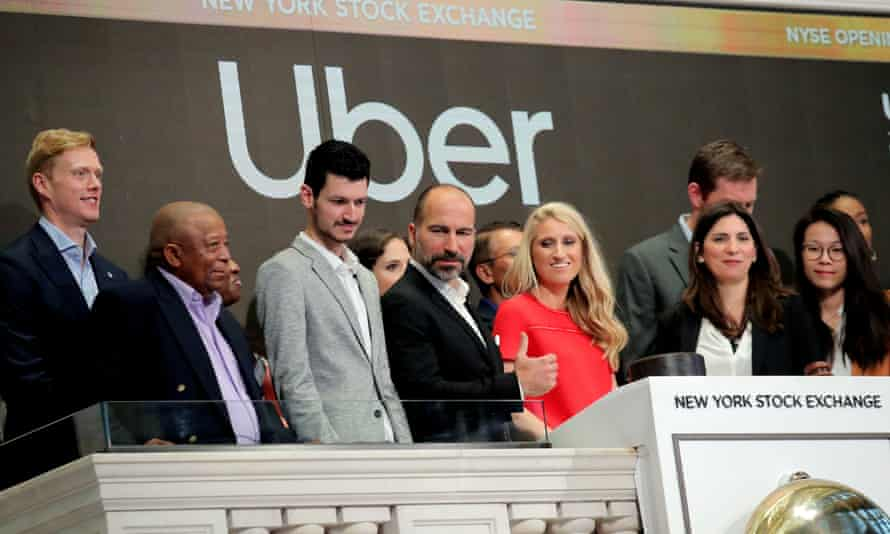 Uber CEO, Dara Khosrowshahi, with staff at the opening bell ringing